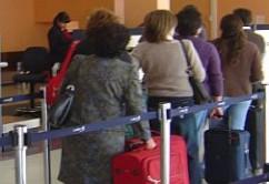 filas aeropuerto pasajeros