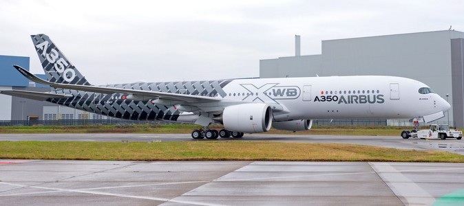 "A350 MSN2 rolls out of paint hangar with special ""˜Carbon""™ livery"