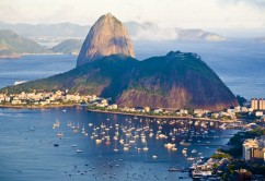 High-angle view of Sugarloaf Mountain and Botafogo Bay at sunset, Rio de Janeiro, Brazil. Sugarloaf is one of the major identifying landmarks of Rio de Janeiro